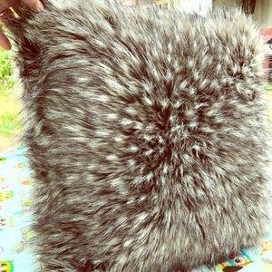 Fluffy, fuzzy throw pillow